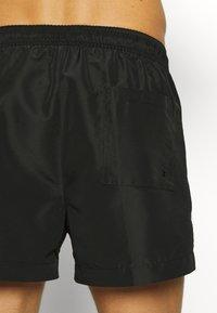 Calvin Klein Swimwear - DRAWSTRING - Swimming shorts - black - 1