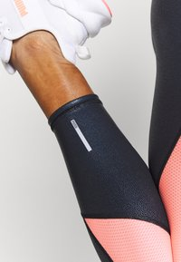 Puma - TRAIN PEARL HIGH WAIST - Legginsy - black/peach