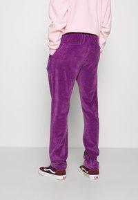 9N1M SENSE - TRACK PANTS UNISEX - Pantalon de survêtement - purple - 3