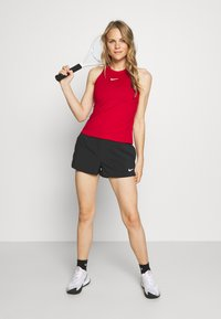 Nike Performance - DRY TANK - Sports shirt - gym red/white - 1