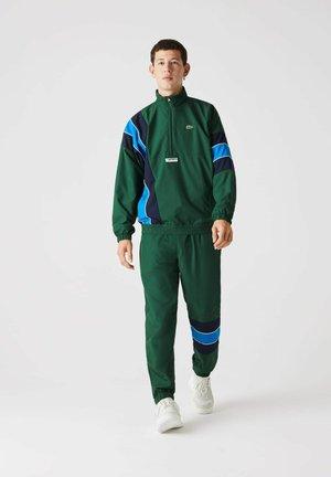 XH2448 - Tracksuit bottoms - grün / navy blau / blau / weiß