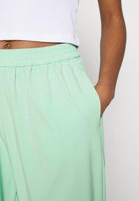 NA-KD - NA-KD X ZALANDO EXCLUSIVE - SPORTY FABRIC PANTS - Tracksuit bottoms - fresh mint - 3