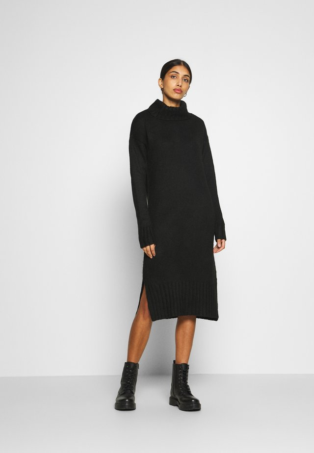 ROLL NECK DRESS - Stickad klänning - black
