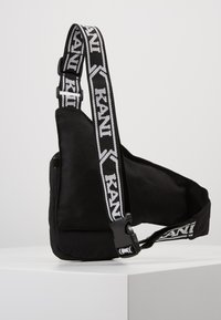 Karl Kani - SIGNATURE TAPE BODY BAG - Bum bag - black/white - 3