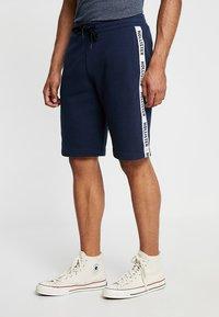 Hollister Co. - TAPED - Pantalones deportivos - navy - 0