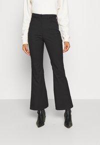 Monki - RAMONA TROUSERS - Flared Jeans - black - 0