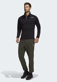 adidas Performance - TERREX HIKE TROUSERS - Friluftsbukser - green - 1
