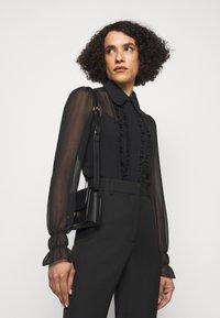 Victoria Beckham - FRILL DETAIL BLOUSE - Button-down blouse - black - 4