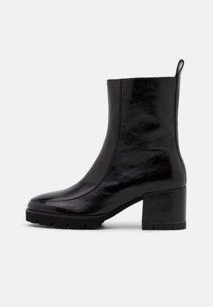 CORI - Platform ankle boots - schwarz