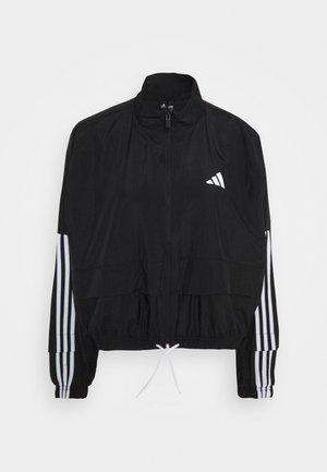 COVER UP - Training jacket - black