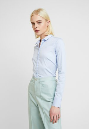 TILDA  - Button-down blouse - light blue
