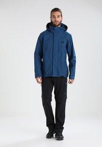 Jack Wolfskin - ACTIVATE LIGHT ZIP OFF - Outdoor trousers - black - 1