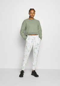 Cotton On Body - GYM TRACK PANT - Tracksuit bottoms - mint chip - 1