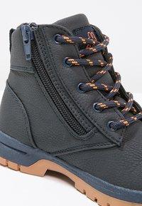 Kappa - CAMMY  - Hiking shoes - navy/orange - 5