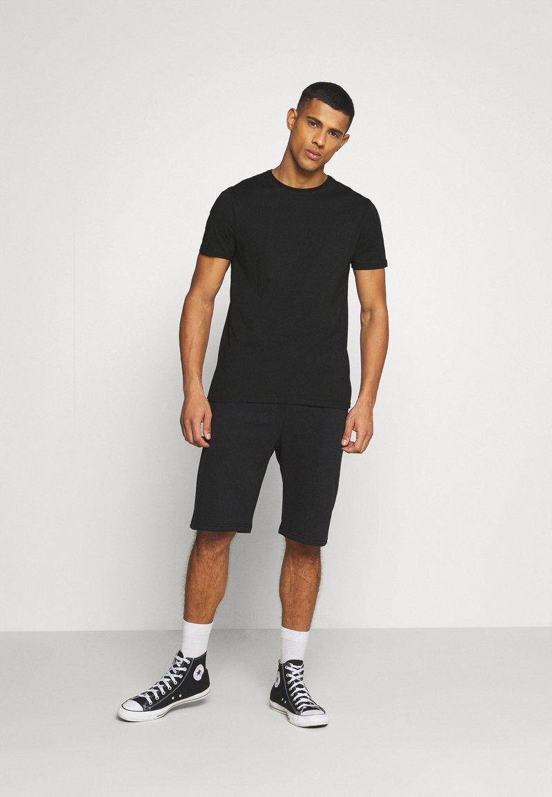YOURTURN - UNISEX SET - Shorts - black
