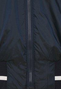 J.LINDEBERG - MALOU PADDED GOLF JACKET - Outdoor jacket - navy - 4