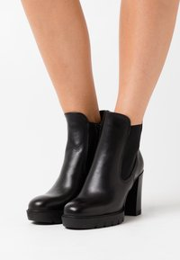 Tamaris - BOOTS - High heeled ankle boots - black - 0