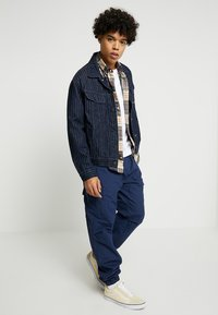 Carhartt WIP - JOGGER COLUMBIA - Cargo trousers - blue rinsed - 1