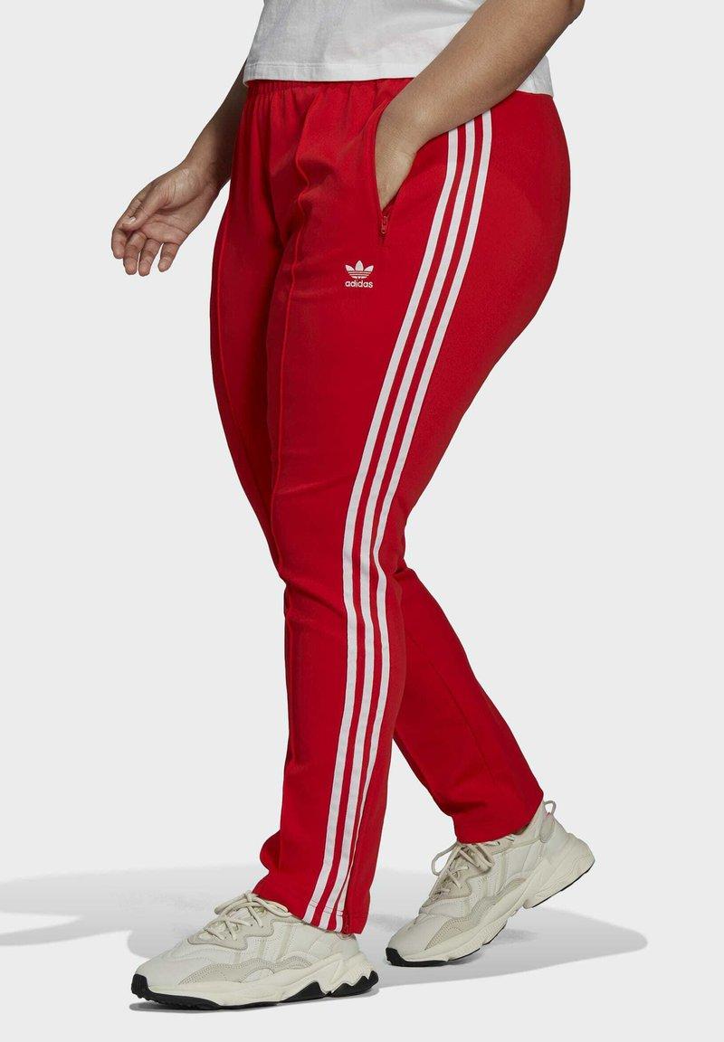 adidas Originals - PRIMEBLUE SST - Tracksuit bottoms - red