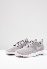 Nike Performance - WMNS NIKE FLEX ESSENTIAL TR - Sports shoes - atmosphere grey/pink quartz/echo pink/vast grey/white - 2