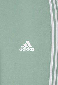 adidas Performance - Tracksuit bottoms - haze green/white - 2