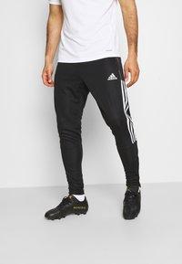 adidas Performance - TIRO 21 - Tracksuit bottoms - black/white - 0