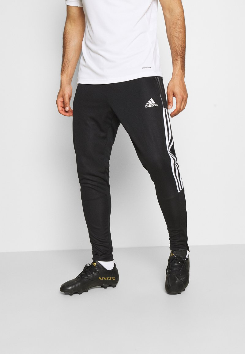 adidas Performance - TIRO 21 - Tracksuit bottoms - black/white