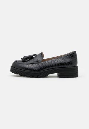 FINN CHUNKY TASSEL LOAFER - Slippers - black