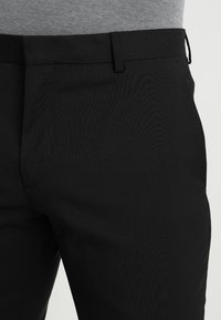 Calvin Klein Tailored - WOOL NATURAL STRETCH FITTED SUIT - Suit - perfect black - 8