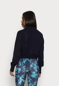 Topshop Petite - TIE DYE FLARE - Trousers - blue - 2