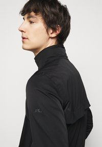 J.LINDEBERG - TERRY POLY STRETCH - Short coat - black - 4