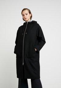 Monki - LEMON HOODED COAT - Kåpe / frakk - black dark - 0
