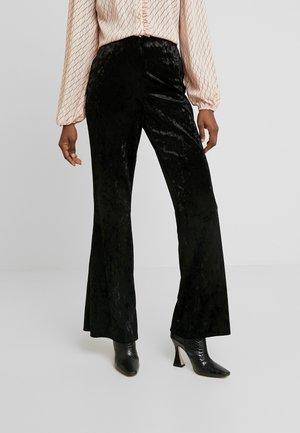 LOLA SKYE GLITTER FLARE - Trousers - black
