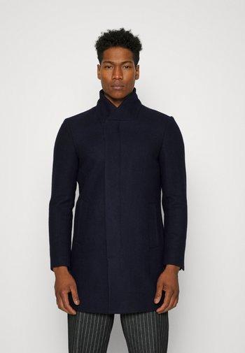 HIDDEN BUTTON PLACKET - Classic coat - navy