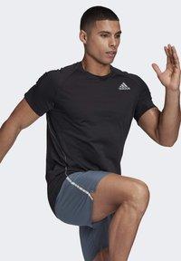 adidas Performance - SUPERNOVA PRIMEGREEN RUNNING SHORT SLEEVE TEE - Print T-shirt - black - 4