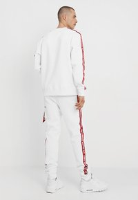 Alpha Industries - JOGGER TAPE - Tracksuit bottoms - white - 2