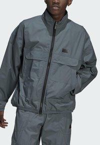 adidas Originals - FASHION TT - Training jacket - blue - 2