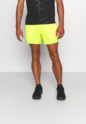 STRIDE  - Sports shorts - gelb/silber