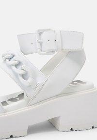 Buffalo - VEGAN ROCKET - Platform sandals - white - 5