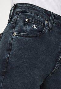 Calvin Klein Jeans - HIGH RISE SKINNY - Jeans Skinny Fit - blue grey shank - 4