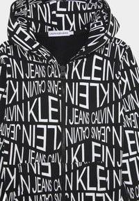 Calvin Klein Jeans - DISTORTED LOGO ZIP HOODIE - Zip-up hoodie - black - 0