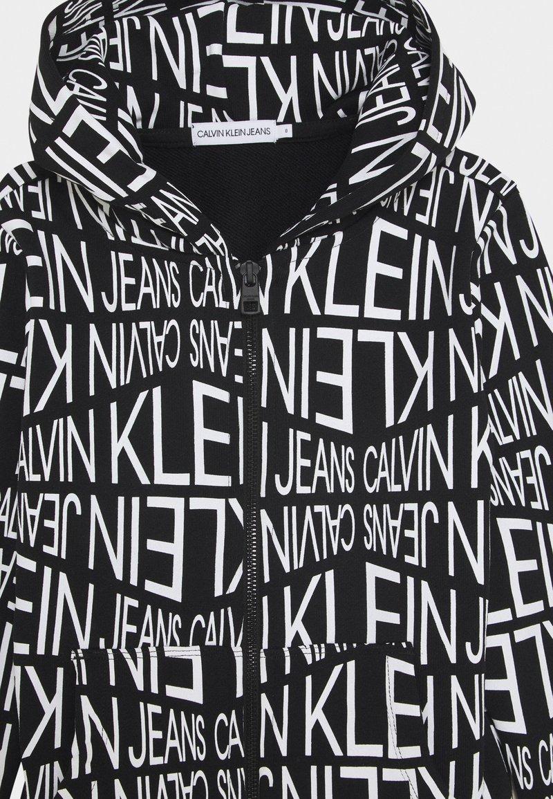 Calvin Klein Jeans - DISTORTED LOGO ZIP HOODIE - Zip-up hoodie - black