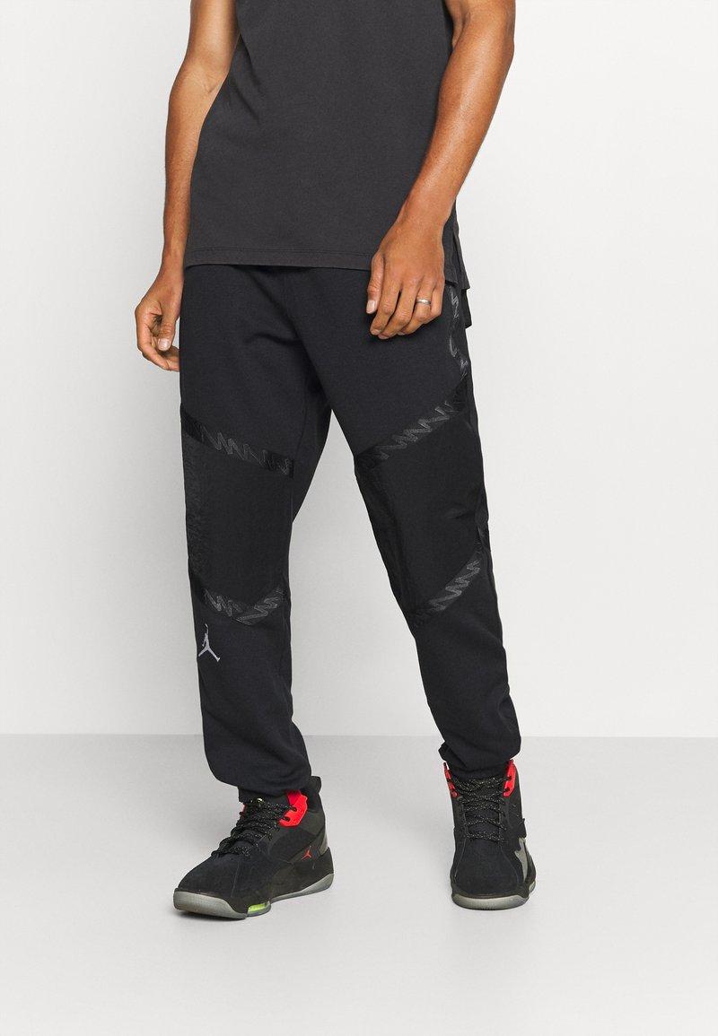 Jordan - ZION WILLIAMSON PANT - Spodnie treningowe - black/white