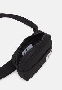 Calvin Klein Jeans - MONOGRAM BADGE WAISTBAG UNISEX - Bum bag - black - 2