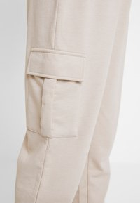 Missguided - UTILITY POCKET HIGH WAISTED - Tracksuit bottoms - nude - 4