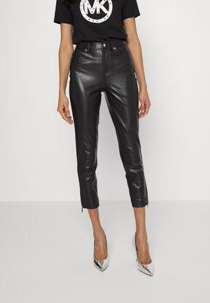 FAUX  - Trousers - black