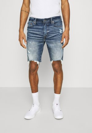INDIGO CUT OFF NO CUFF - Denim shorts - medium wash