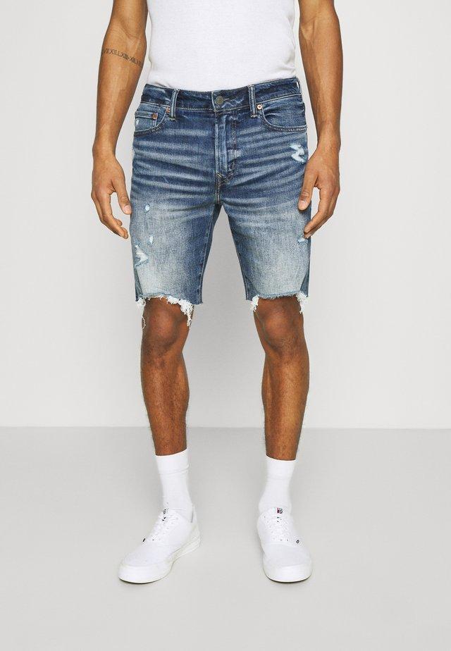 INDIGO CUT OFF NO CUFF - Short en jean - medium wash