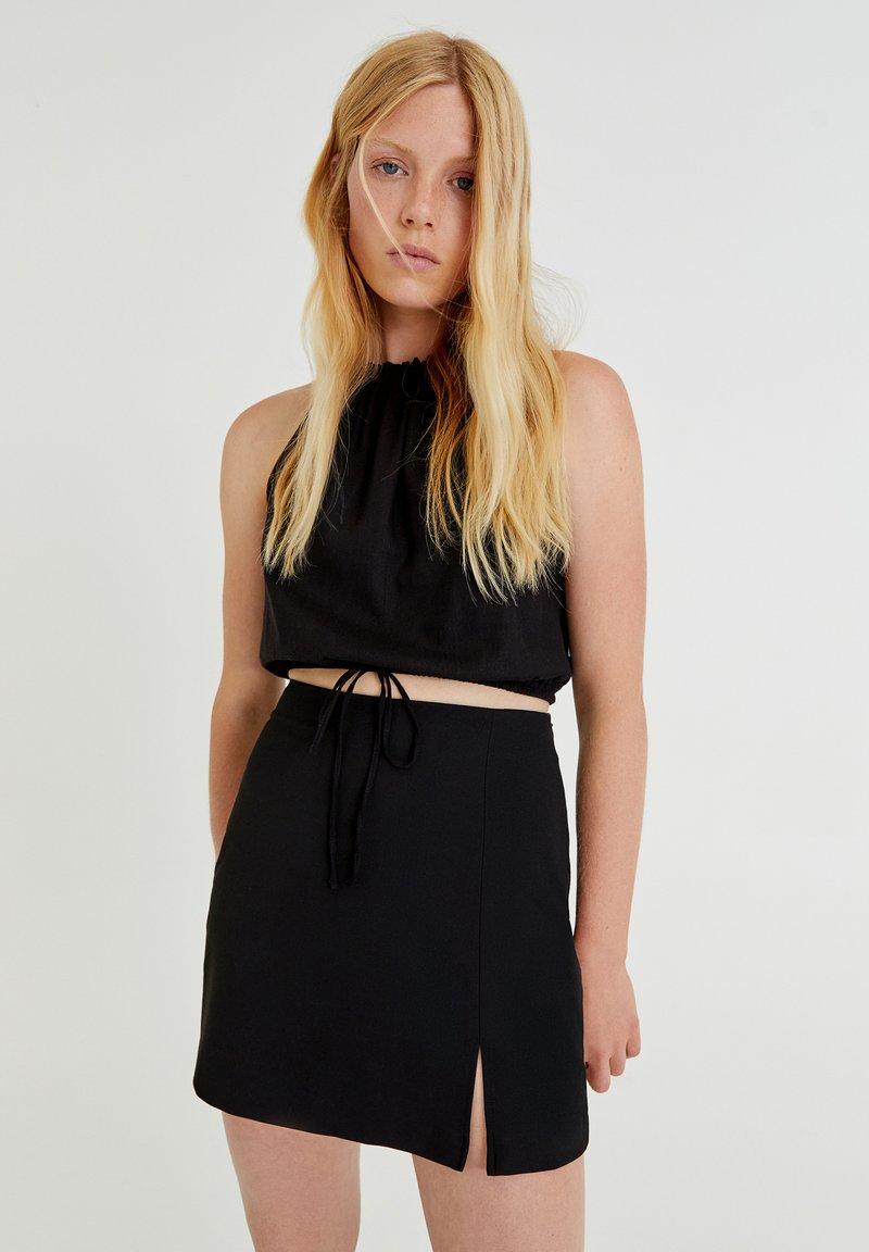 PULL&BEAR - MIT SCHLITZ - A-line skirt - black