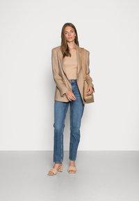 Nudie Jeans - LOFTY LO FAR OUT - Straight leg jeans - blue denim - 1